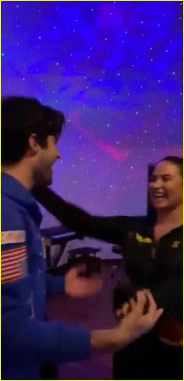 demi lovato boyfriend max ehrich kiss and dance in ariana justin music video 03