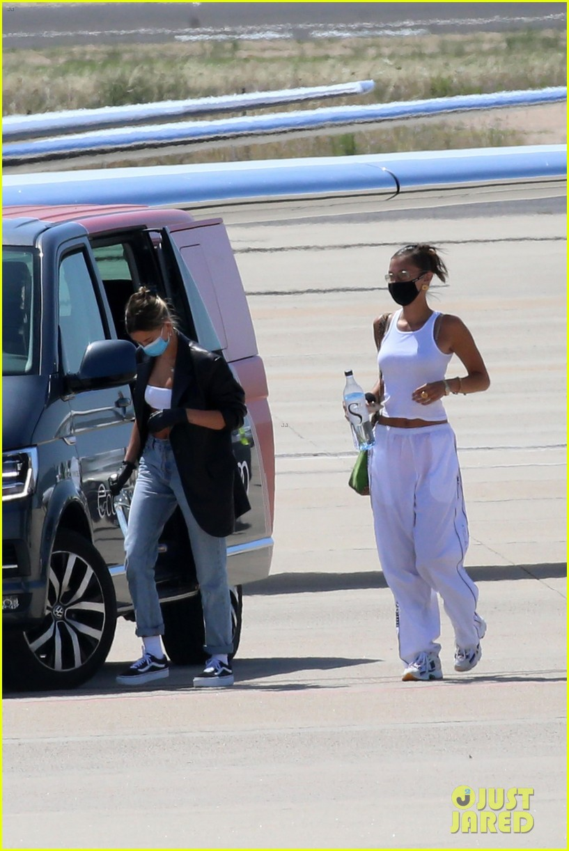 hailey bieber bella hadid fly home from sardinia 26