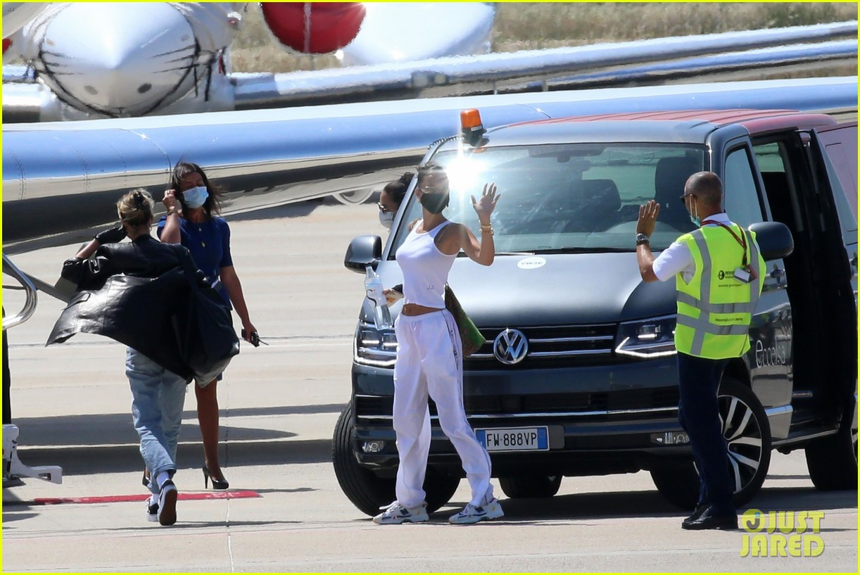 hailey bieber bella hadid fly home from sardinia 28