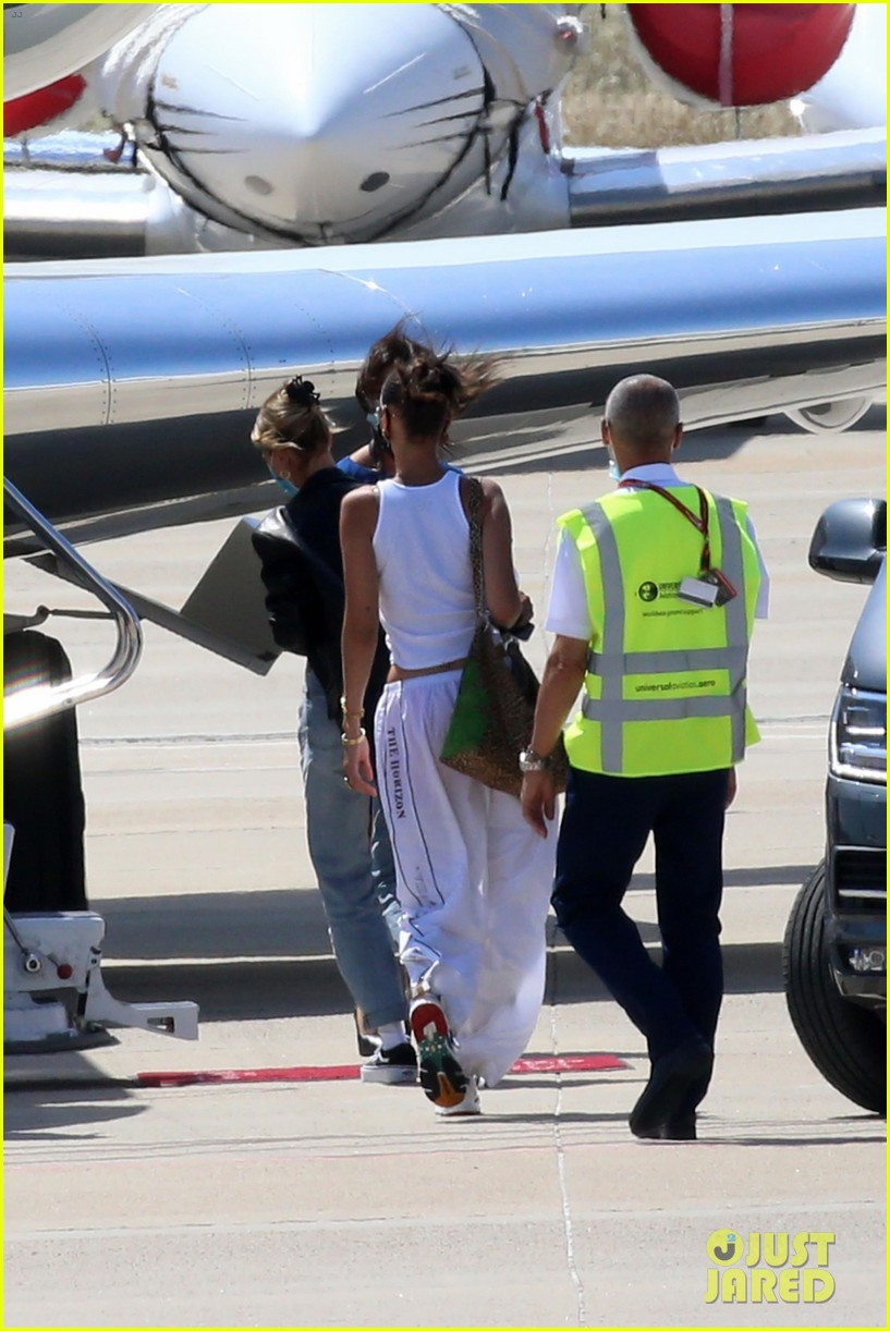 hailey bieber bella hadid fly home from sardinia 30
