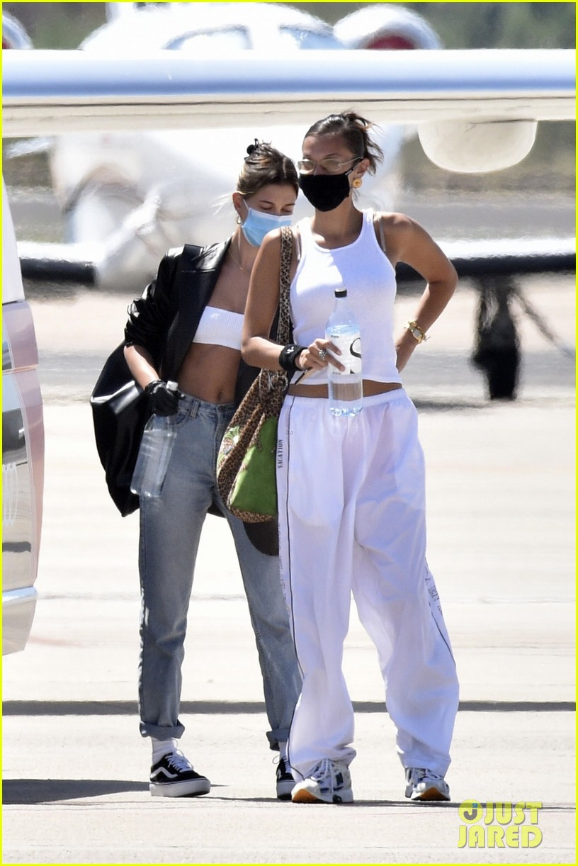 hailey bieber bella hadid fly home from sardinia 41