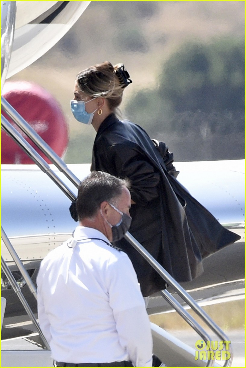 hailey bieber bella hadid fly home from sardinia 47