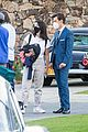 harry styles looks dapper in two suits on dont worry darling set in palm springs 35
