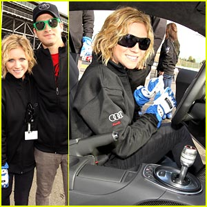 Brittany Snow Learns To Ride an Audi