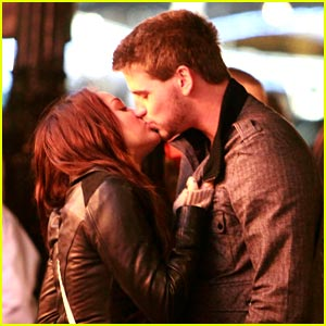Miley Cyrus & Liam Hemsworth Pucker Up in Paris