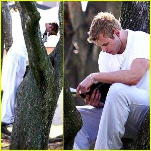 Kellan Lutz Climbs A Tree; Reads a Book