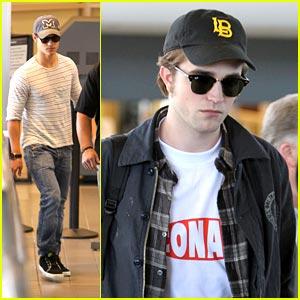 Robert Pattinson & Taylor Lautner: Back at LAX!
