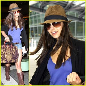 Nina Dobrev: Happy at Heathrow