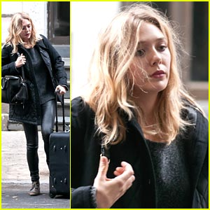 Elizabeth Olsen Packs A Full Suitcase