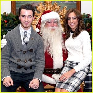 Kevin & Danielle Jonas Sit on Santa's Lap