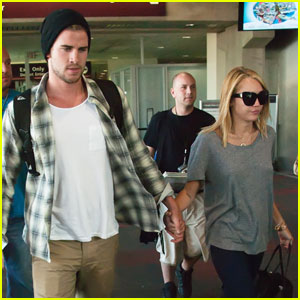 Miley Cyrus & Liam Hemsworth: Airport Arrival with Ziggy!