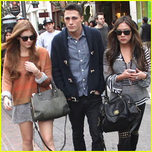 Colton Haynes walks along with two of his favorite ladies