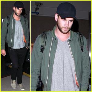 Liam Hemsworth Arrives at LAX Airport