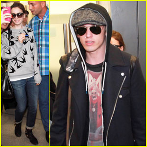 Lily Collins & Jamie Campbell Bower Arrive in Berlin