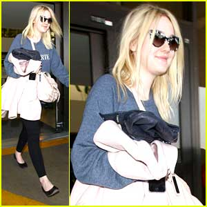 Dakota Fanning: LAX Landing After Knicks Game in NYC