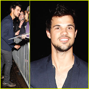 Taylor Lautner Stops For Fans After Private Pre-Oscars Party