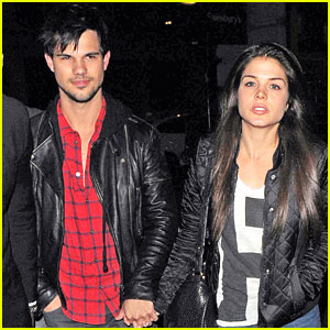Taylor Lautner & Marie Avgeropoulos Wear Matching Black Jackets in London