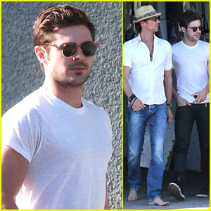 Zac Efron Wears Tight White Tee While Out With Barefoot Friend