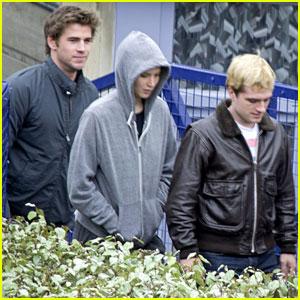 Jennifer Lawrence, Liam Hemsworth, & Josh Hutcherson are a 'Mockingjay' Paris Trio!