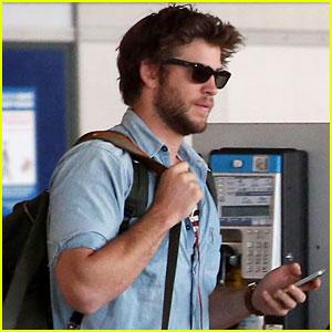 Liam Hemsworth Arrives in Paris for 'Hunger Games: Mockingjay' Filming