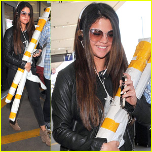 Selena Gomez Carries Two Large Rolls At LAX