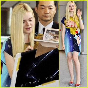 Elle Fanning Wears a Sleeping Beauty Dress as She Arrives in Japan!