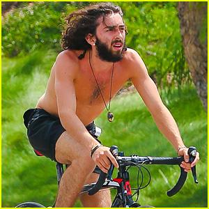 Mateo Arias Takes a Shirtless Bike Ride with a Full Beard & Long Hair