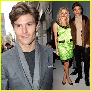 Oliver Cheshire Brings Pixie Lott To Moschino Show During London Collections