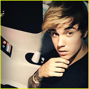 Justin Bieber Sports His Trademark Hairstyle
