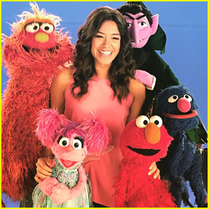 Gina Rodriguez Steals Kisses From Sesame Street's Elmo!
