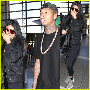 Kylie Jenner & Tyga Coordinate Their Black Outfits at LAX Airport