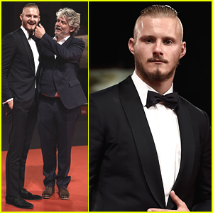 Alexander Ludwig Pretends To Bite Director Daniel Alfredson At 'Go With Me' Premiere in Venice