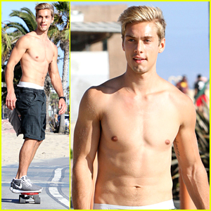 Austin North Skateboards Shirtless Before Slipping On A Piece Of Pizza