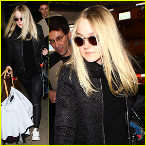 Dakota Fanning Touches Down at LAX After Paris Fashion Week