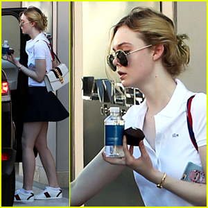 Elle Fanning Looks Preppy in Pleated Skirt