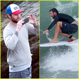 Liam Hemsworth Watches Brother Chris Surf The Day Away