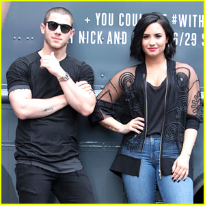 Demi Lovato & Nick Jonas Hand Out Free Treats in Atlanta