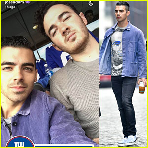 Joe & Kevin Jonas Take in New York Giants Game With Friends & Family!