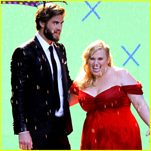 It IS Romantic! Liam Hemsworth Gives Rebel Wilson a Kiss in the Rain!