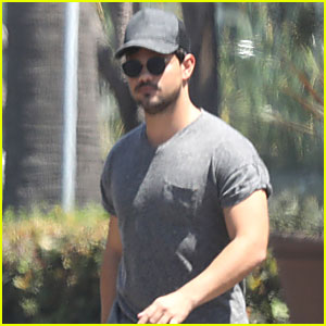 Taylor Lautner Does Back Flip Into Pool Fully Clothed