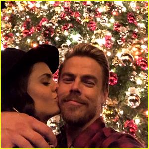 Derek Hough & Girlfriend Hayley Erbert Kiss Under The Christmas Tree