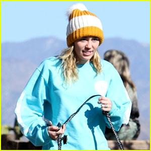 Miley Cyrus Rocks Cute Pom-Pom Beanie While Walking Her Dog