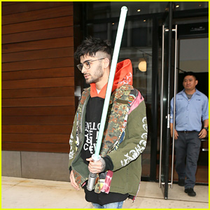 Zayn Malik Carries a Lightsaber Out of the Studio!