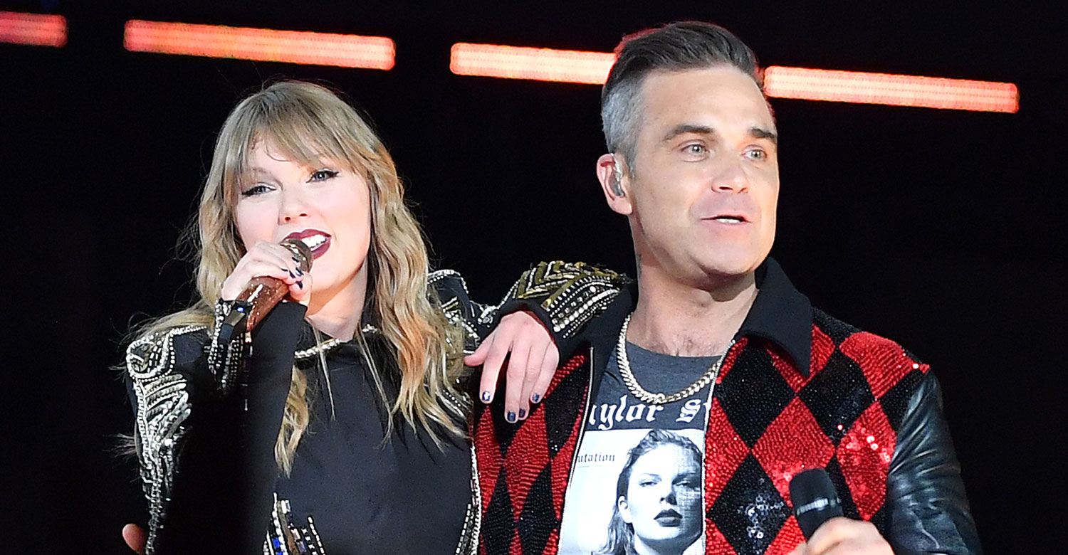 Taylor Swift Brings Special Guest Robbie Williams On Stage