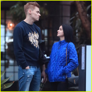 Ariel Winter Braves the Rain With Boyfriend Levi Meaden