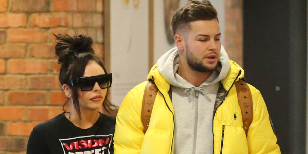 jesy nelson holds hands with chris hughes while arriving