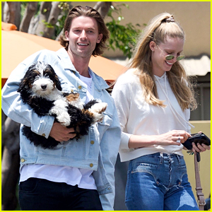 Patrick Schwarzenegger Cradles Adorable Puppy In His Arms After Lunch With Abby Champion