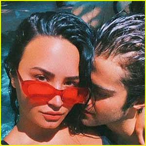 Demi Lovato & Max Ehrich Cuddle Up In The Pool In New Photos