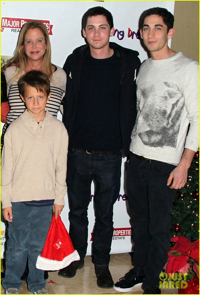 logan lerman working dreams toy drive 03