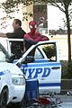 Andrew-cop andrew garfield stands on cop car for spider man 2 04